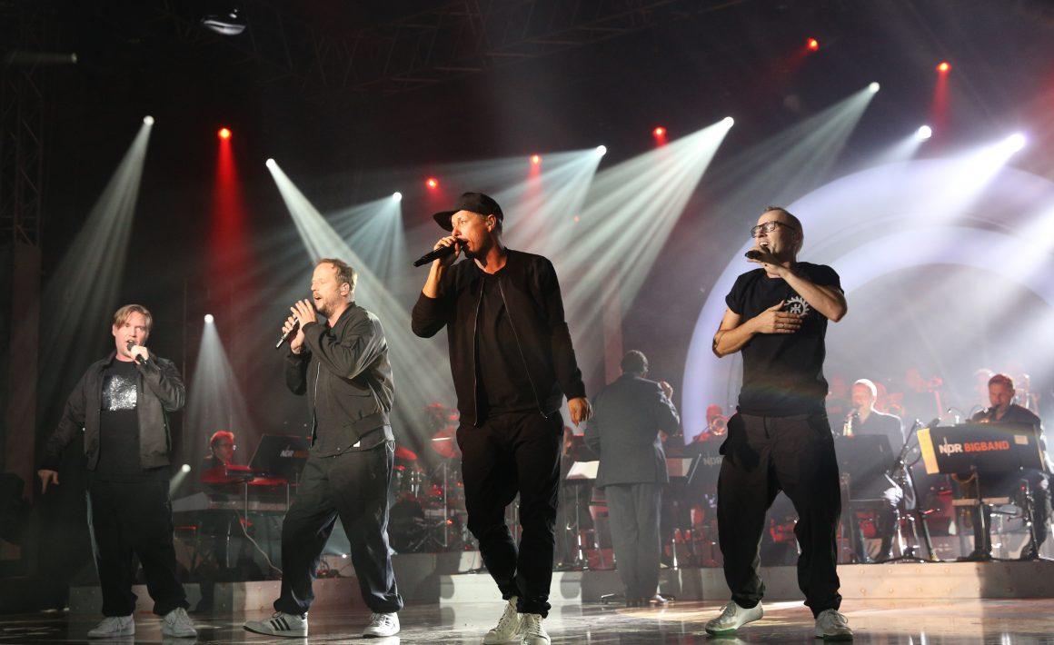 Die Fantastischen Vier auf einer Bühne